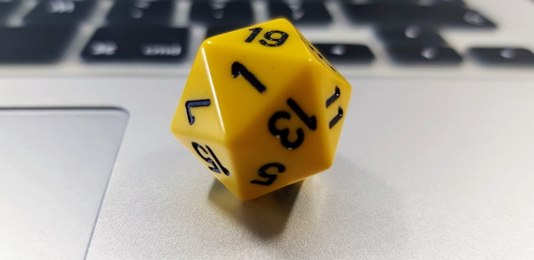 20-sided dice on a laptop