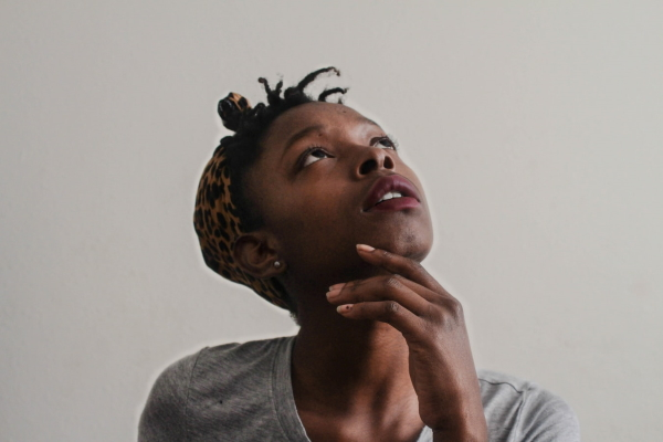 Woman looking up while thinking